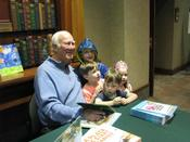 Author David Harrison pauses during a book signing at the Library Center to pose for a photo with young fans.