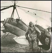 Amelia Earhart poses with an auto-giro.