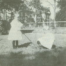 The Cooper sisters playing on lawn in 1896.  In the background is the home of Thomas Josiah Keet.